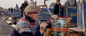 1960's boatman painting a water can